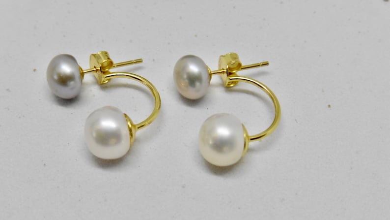 Double stud earrings with round beads white with grey two in image 0
