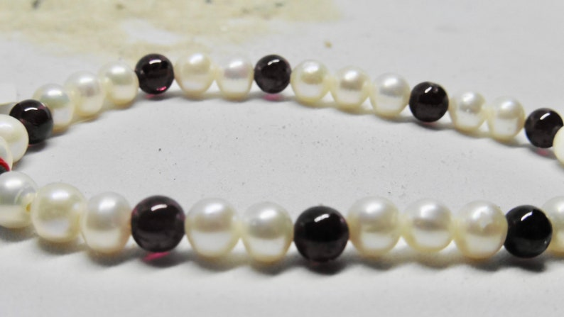 Elastic bracelet endless with real freshwater pearls and image 0