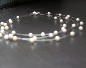 Fine delicate bridal necklace made of real pearls 3-row floating on wire with silver