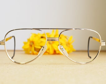 29341051fb Vintage Eyeglasses 1980s Glasses New Old Stock hipster frames Silver Tone  By Titmus Frames Aviator Style Cable temples