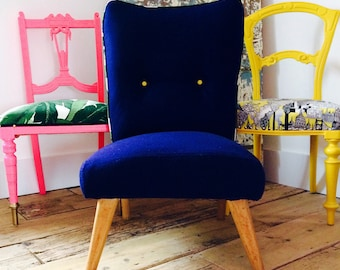 Mid century chair in blue wool.