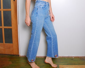 75a72b522c6 90s 26 x 27 flower embroidered blue jean denim womens mid rise hippie pants  Revolt kids 14 worn in boho vintage clothing cropped distressed