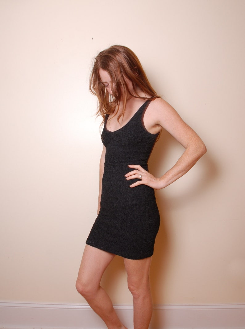 tight black mini dress