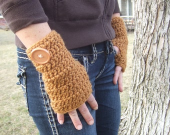 Tan fingerless gloves with large button