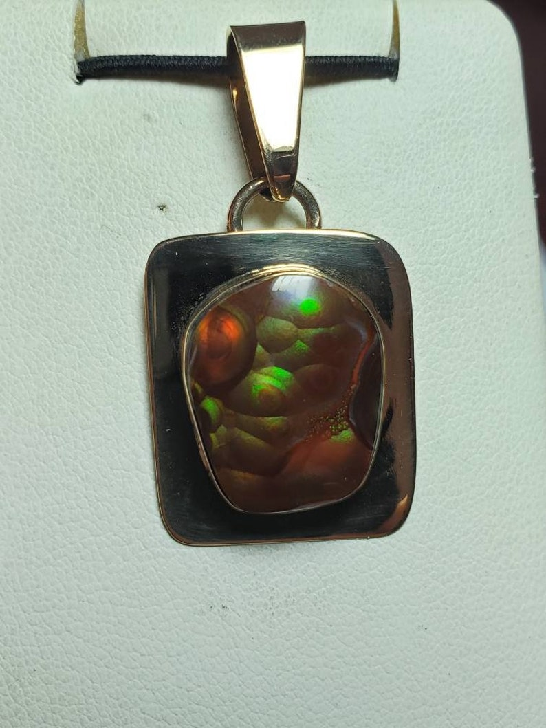 Mined on Apache Indian Reservation Arizona Beautiful. Set in 14K Gold Filled material Fire agate pendant from slaughter mountain