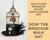 Birdcage Hat    Steampunk top hat with a singing bird a bird cage and custom decorated with animated singing bird Custom made by Cindy Chinn