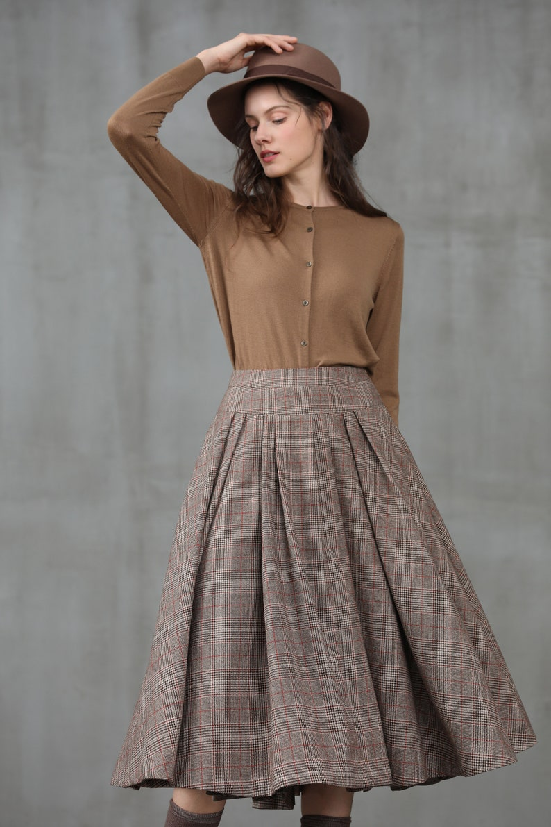 50s Skirt Styles | Poodle Skirts, Circle Skirts, Pencil Skirts 1950s pleated check wool skirt midi wool skirt winter skirt wool winter skirt vintage skirt brown skirt party skirt | Linennaive $119.00 AT vintagedancer.com