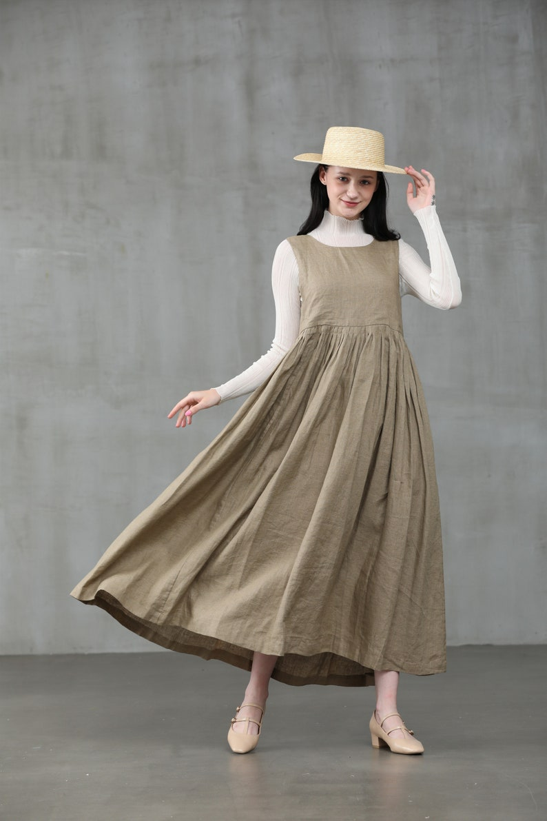 1920s Outfit Ideas: 10 Downton Abbey Inspired Costumes apron linen dress pleated linen dress bow linen dress linen midi dress | Linennaive $119.00 AT vintagedancer.com