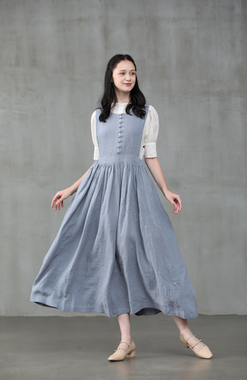 Cottagecore Clothing, Soft Aesthetic apron linen dress in misty blue pleated linen dress bow linen dress linen midi dress | Linennaive $109.00 AT vintagedancer.com
