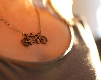 Tandem bicycle necklace made of laser-cut bamboo
