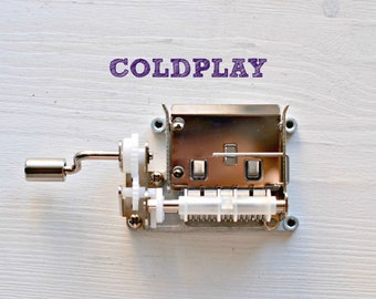Coldplay Music mechanism. Your favourites Coldplay songs in a hand cranked musical mechanism of 15 notes. Everglow, fix you, amazing day...