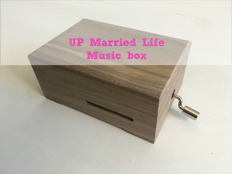Up, married life  Wooden music box with a hand cranked musical mechanism of  15 notes  Choose a second gift melody