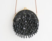 Black embroidered sequined evening bag with pearls and long shoulder chain