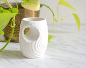 Vintage bisque vase with shell pattern