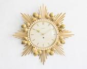 Large sun shaped brass wall clock