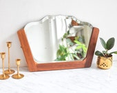 Antique faceted entryway mirror