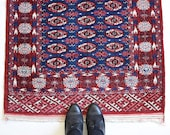 Small Oriental Red Woven Carpet