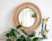 Round vintage rattan mirror