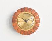 Brass wall clock, sunburst clock