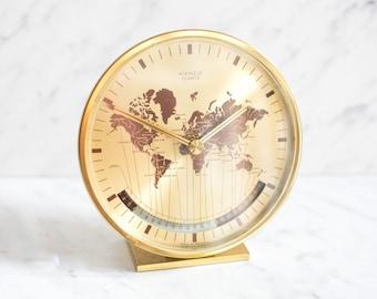 Brass world clock with time zones by Kienzle