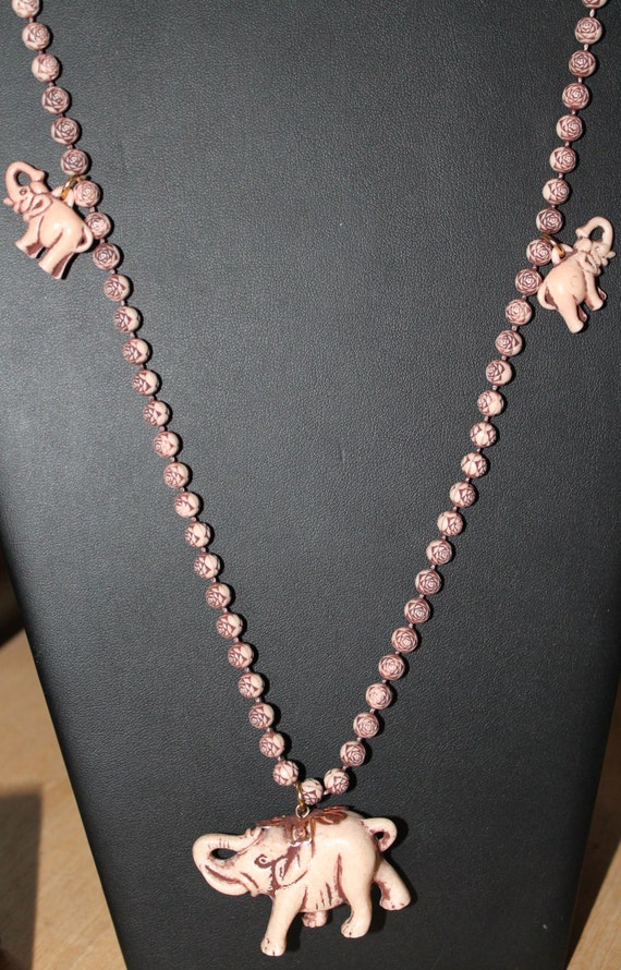 NECKLACE Vintage carved lucite beaded necklace: pink elephant and roses  from 60s