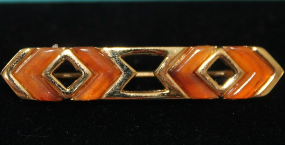 BROOCH Beautiful original Couture GIVENCHY  signed 1978 brooch , gold metal, amber lucite details, perfect.