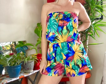 7a6ce963fe8 Vintage 70s 80s tropical floral + palm print sleeveless romper 1980s booty  shorts hot pants front bow tie elastic waist beach cover up S