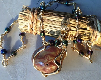 Brown Stone Pendant Wrapped in Gold