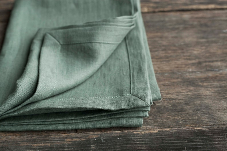 Green stonewashed linen table runner with mitered corners in image 0