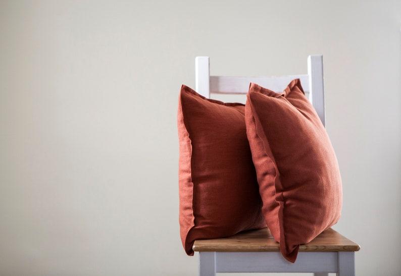 Burnt orange throw pillow with 2 cm edge around. Linen pillow image 0