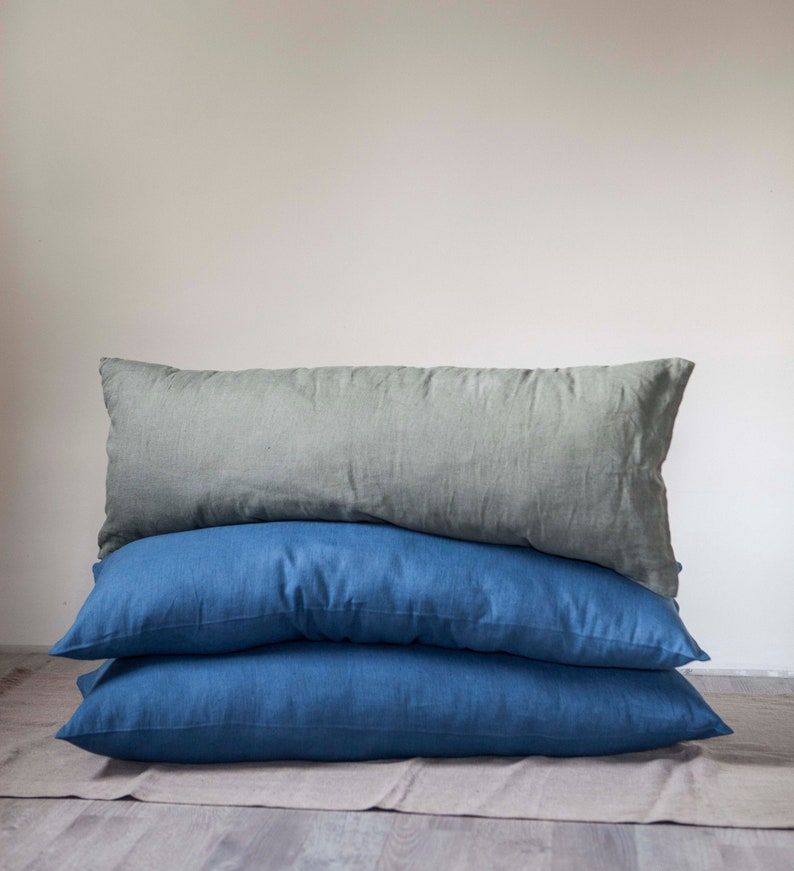 3 lumbar pillow covers in blue and seafoam green. 2 blue and 1 image 0