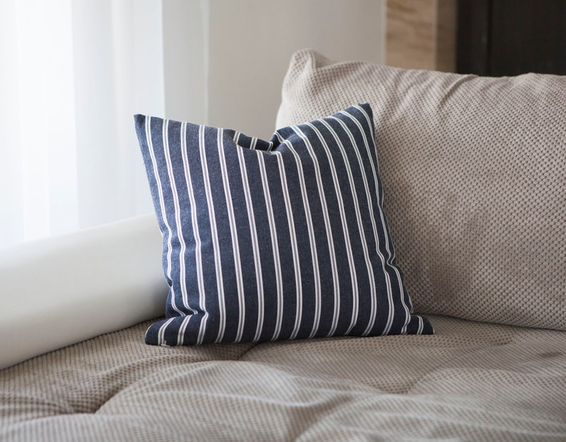Blue striped throw pillow for outdoors and patio furniture image 0