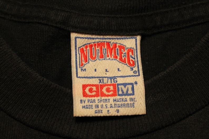 ac5d0f6923a Charlotte Hornets shirt vintage NBA basketball graphic tee | Etsy