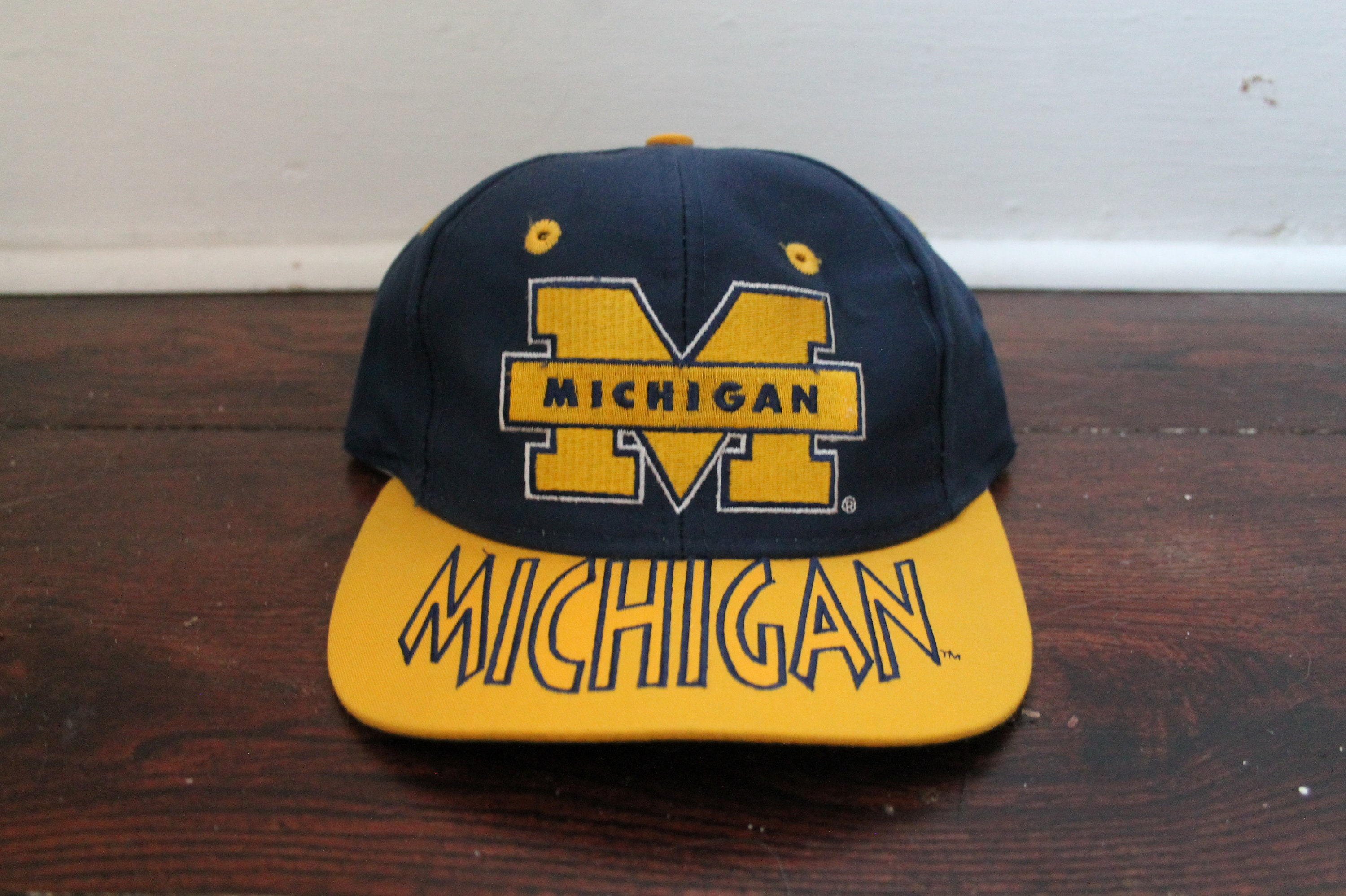 quality design 5cfb3 7e4c0 Michigan Wolverines snapback blue yellow script big logo   Etsy