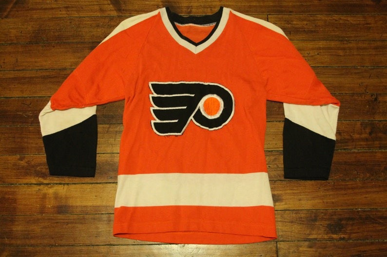 67252ec9cd9 Philadelpia Flyers jersey 1970s vintage NHL hockey jersey | Etsy