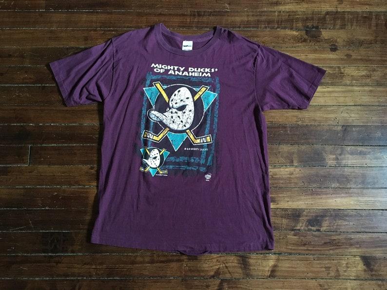35c6aee8 Anaheim Mighty ducks shirt NHL hockey tshirt jersey purple   Etsy