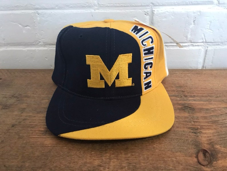 new product a1157 d61f9 Michigan Wolverines snapback hat deadstock vintage swirl logo   Etsy