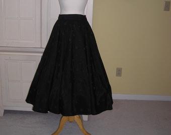 40's full black circle skirt,  Size 13.  Flocked polka dots of different sizes on taffeta skirt.