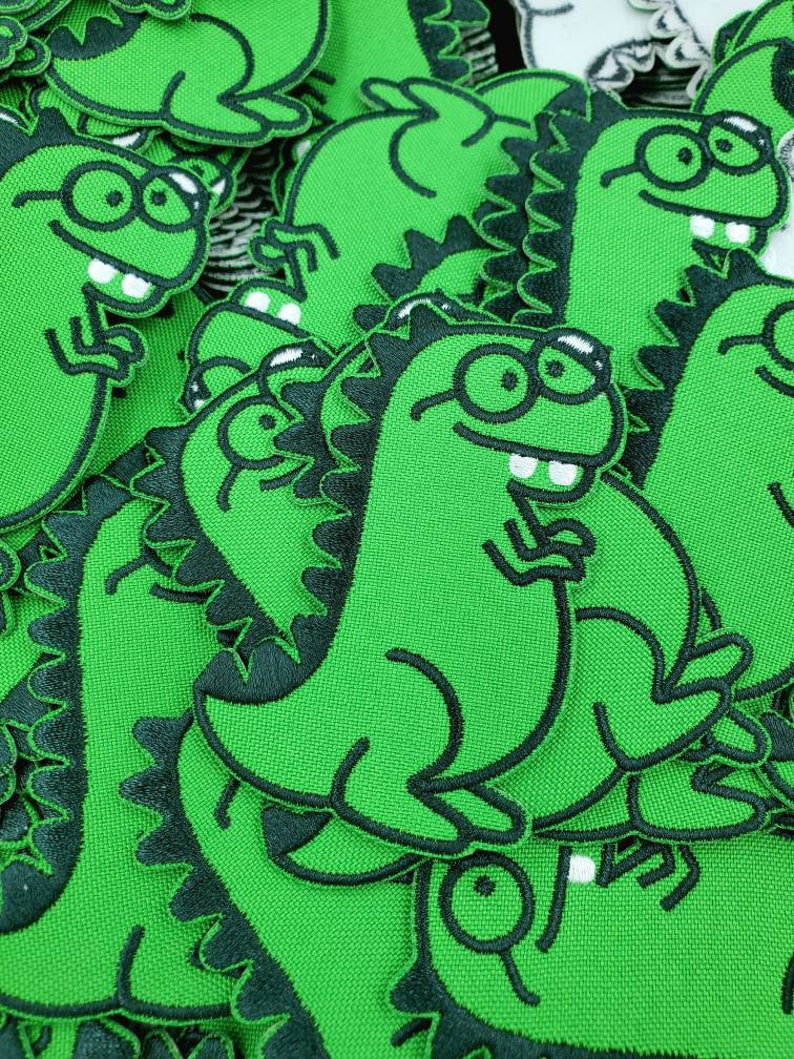 Dorky Dino Iron On Patch: Cute T-Rex with Glasses and Buck image 0