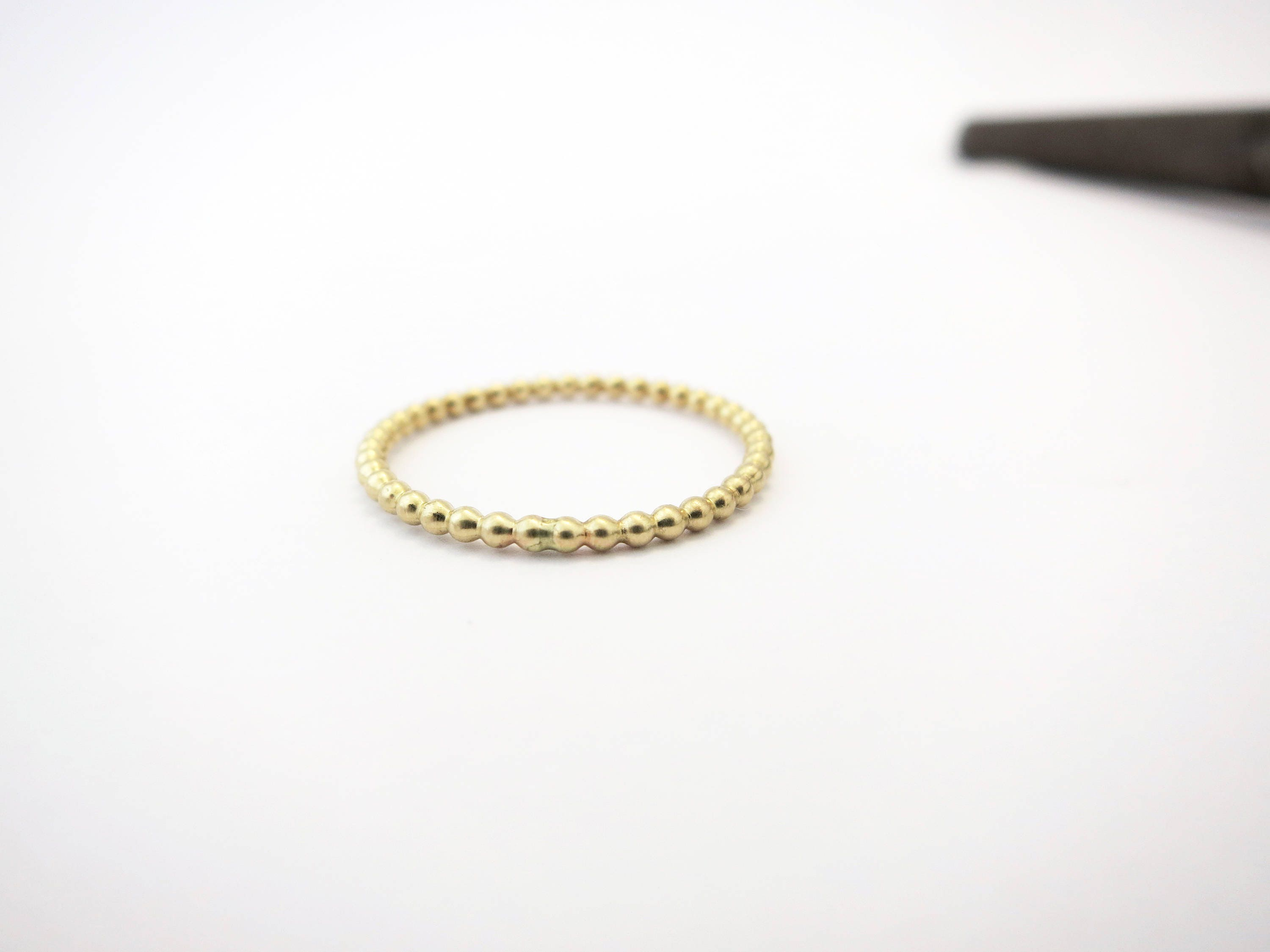It is a picture of Wedding band women, Thin wedding band, Solid gold ring, Minimalist wedding band, Beaded gold ring, Simple wedding band, Stacked ring, 46k