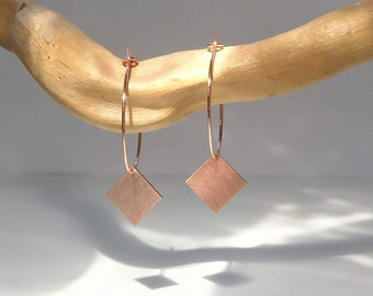 copper-coloured hoop earrings with square copper pendant