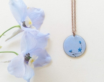 light blue enamel necklace painted with blue flowers