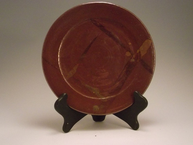 Brown plate with bronze hi lights perfect with cheese and crackers
