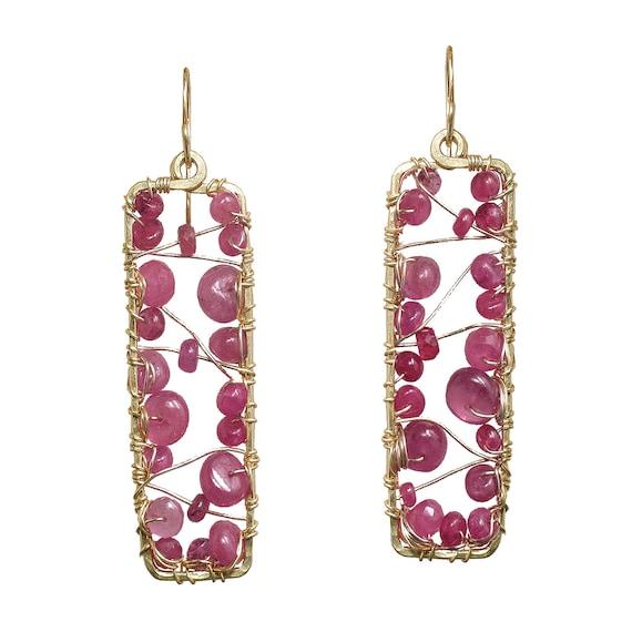 Hammered metal swirl earrings with Ruby Venus 111