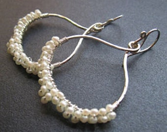 Hammered drop hoops wrapped with ivory pearls Cosmopolitan 44
