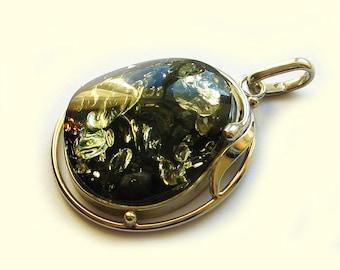 Genuine Baltic green amber pendant.