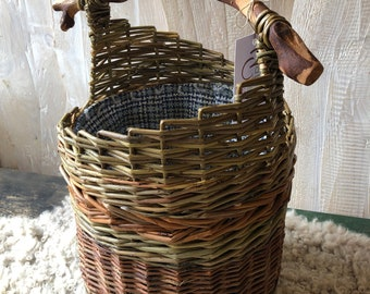 Lined basket with wooden handle.