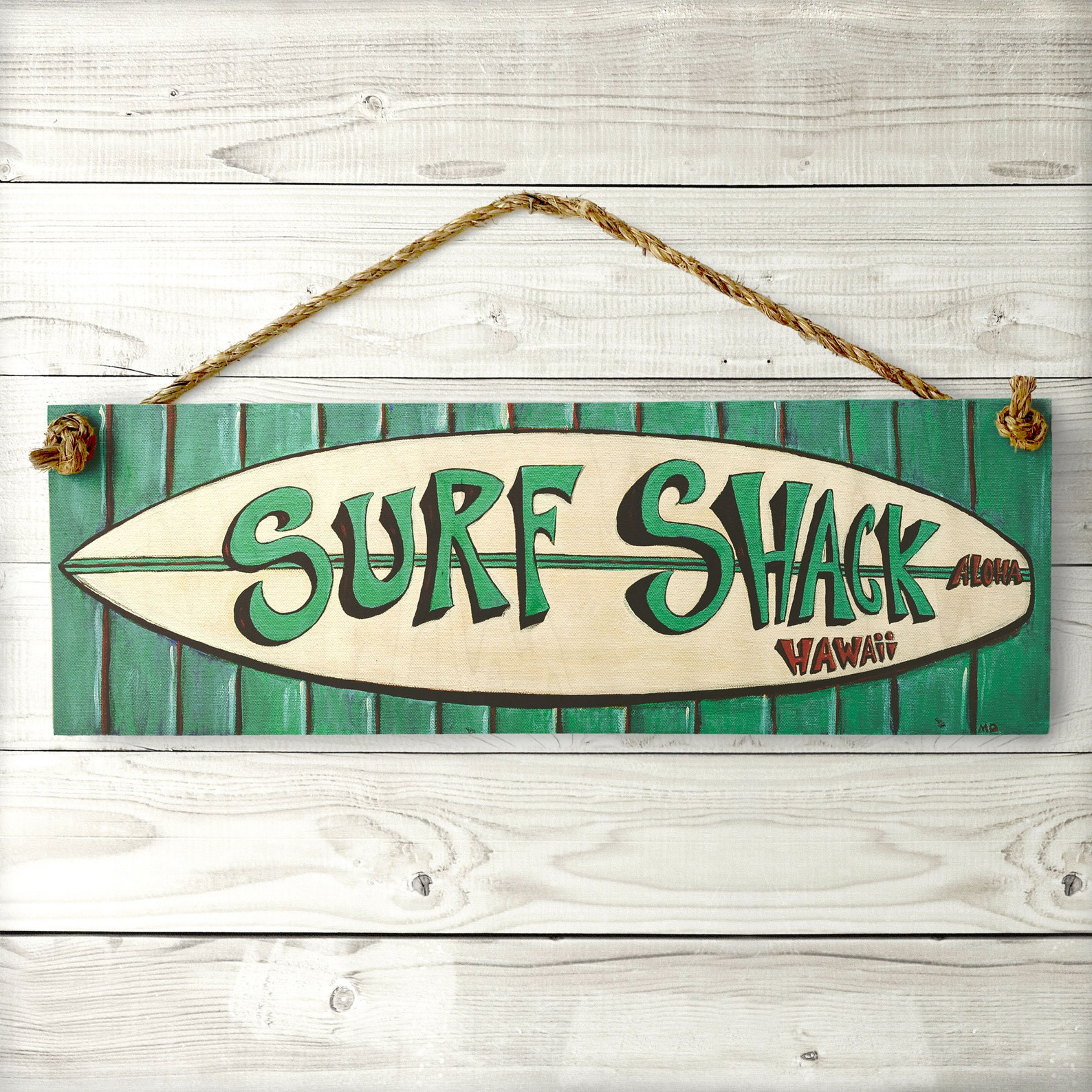 A wooden surf shack sign is one of the coolest Hawaiian souvenir ideas