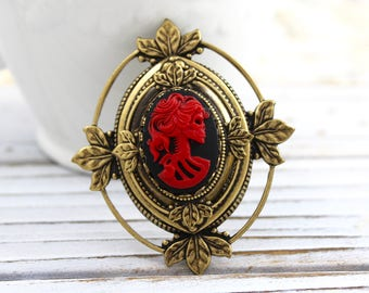 Antique gold plated finish Victorian Steampunk Skeleton Cameo brooch, pin, red black