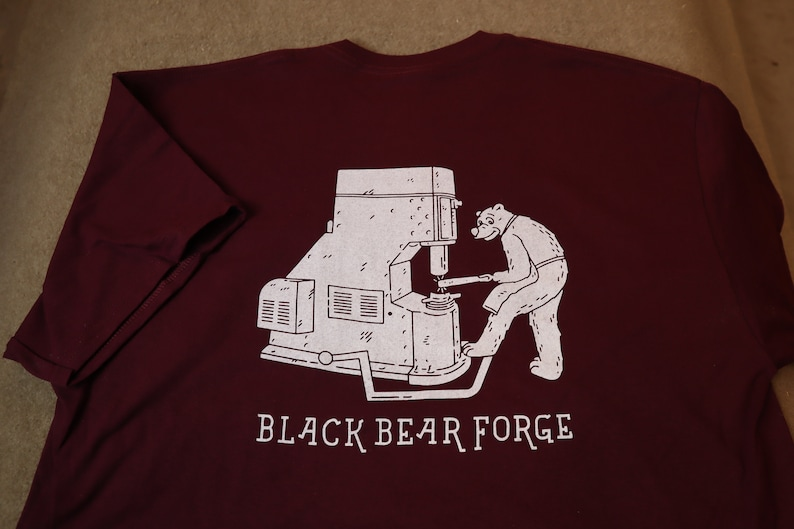 Bear working with power hammer. Black Bear Forge Tee shirt image 0